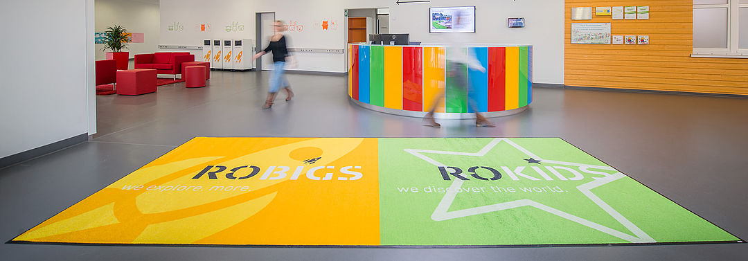 Logo mats as shoe wipers in schools and nurseries